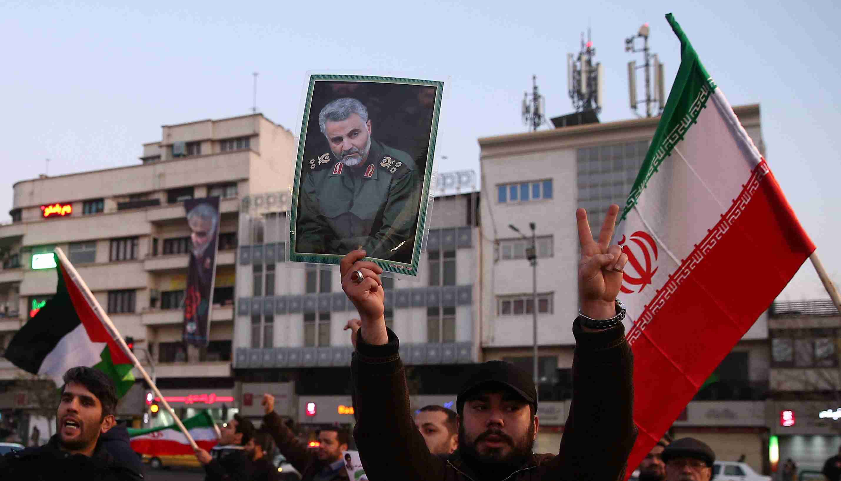 A man holds a picture of late Iranian Major-General Qassem Soleimani, as people celebrate in the street after Iran launched missiles at U.S.-led forces in Iraq, in Tehran, Iran January 8, 2020. Nazanin Tabatabaee/WANA (West Asia News Agency) via REUTERS ATTENTION EDITORS - THIS IMAGE HAS BEEN SUPPLIED BY A THIRD PARTY