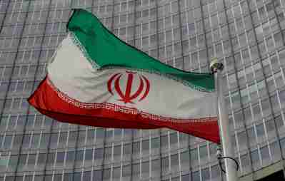 An Iranian flag flutters in front of the International Atomic Energy Agency (IAEA) headquarters in Vienna, Austria September 9, 2019. REUTERS/Leonhard Foeger - RC13159EFD90