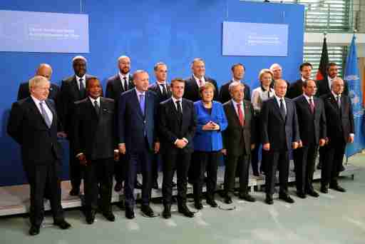 Britain's Prime Minister Boris Johnson, Republic of Congo's President Denis Sassou Nguesso, Turkish President Recep Tayyip Erdogan, French President Emmanuel Macron, German Chancellor Angela Merkel, United Nations Secretary-General Antonio Guterres, Russian President Vladimir Putin, Egyptian President Abdel Fattah al-Sisi, Algerian President Abdelmadjid Tebboune, U.S. Secretary of State Mike Pompeo and European Commission President Ursula von der Leyen pose for a family photo during the Libya summit in Berlin, Germany, January 19, 2020. Murat Cetinmuhurdar/Turkish Presidential Press Office/Handout via REUTERS ATTENTION EDITORS - THIS PICTURE WAS PROVIDED BY A THIRD PARTY. NO RESALES. NO ARCHIVE