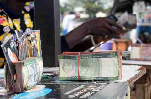 Liberian banknotes are pictured at a money changer's stand in Monrovia, Liberia September 21, 2018. REUTERS/Derick Snyder