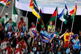 Gold Coast 2018 Commonwealth Games - Closing Ceremony - Carrara Stadium - Gold Coast, Australia - April 15, 2018. Jessie Lartey of Ghana, Roilya Ranaivosoa of Mauritius, Jenito Guezane of Mozambique, Esther Oyama of Nigeria and Esther Oyama of Nigeria  carry the national flags as they walk among athletes and staff members. REUTERS/David Gray