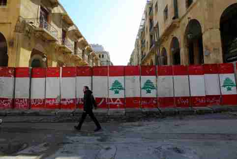 A man walks past concrete barriers erected by authorities to block a street leading to the parliament building in Beirut, Lebanon January 24, 2020. REUTERS/Aziz Taher