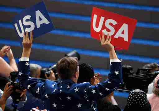 A delegate waves USA signs on the final night of the Democratic National Convention in Philadelphia, Pennsylvania, U.S. July 28, 2016. REUTERS/Mike Segar