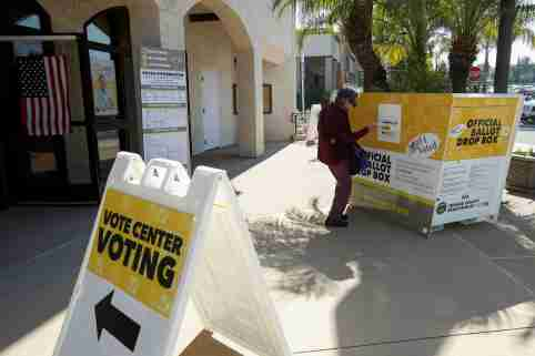 A voter places her ballot at an early voting location in the March 3 Super Tuesday primary in Laguna Woods, California, U.S., February 24, 2020. Picture taken February 24, 2020.      REUTERS/Mike Blake