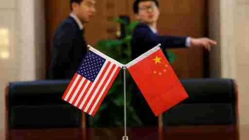 Chinese and U.S. flags are set up for a signing ceremony during a visit by U.S. Secretary of Transportation Elaine Chao at China's Ministry of Transport in Beijing, China April 27, 2018. Picture taken April 27, 2018. REUTERS/Jason Lee - RC13D78E0020