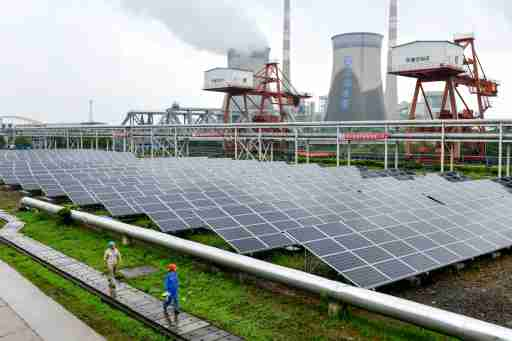 Employees check solar panels, as they work on a grid-connected photovoltaic power generation project, at a power plant in Changxing County, Zhejiang Province, China June 13, 2017. REUTERS/Stringer ATTENTION EDITORS - THIS IMAGE WAS PROVIDED BY A THIRD PARTY. CHINA OUT.