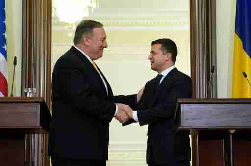 U.S. Secretary of State Mike Pompeo and Ukraine's President Volodymyr Zelensky shake hands during a joint news conference in Kiev, Ukraine January 31, 2020. REUTERS/Kevin Lamarque/Pool