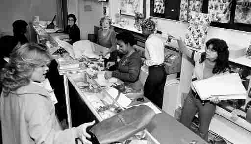 Workers at Cain-Sloan Co downtown store wrapping Christmas gifts for holiday shoppers Dec 13, 1979