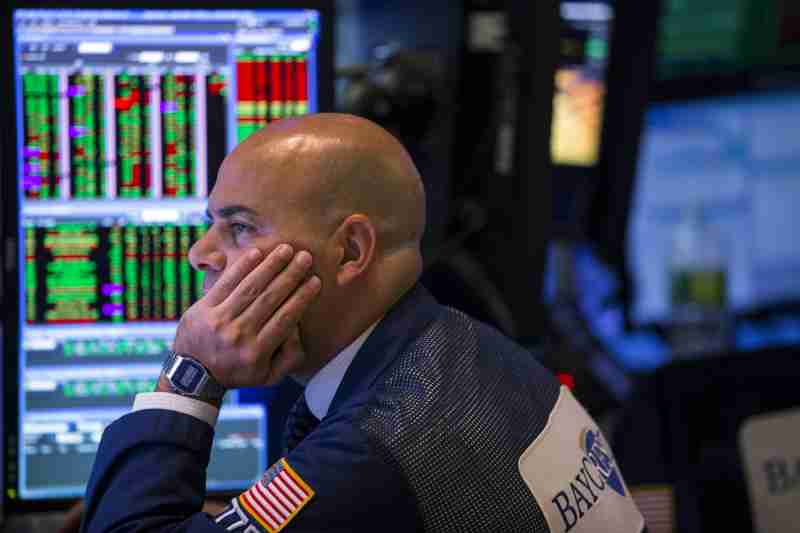 A trader looks at stock prices on a screen while working on the floor of the New York Stock Exchange shortly before the closing bell in New York August 26, 2015. Wall Street was sharply higher on Wednesday while European shares and commodities prices fell as investors balanced strong U.S. economic data and interest rate comments with fears about China's slowing economy.   REUTERS/Lucas Jackson