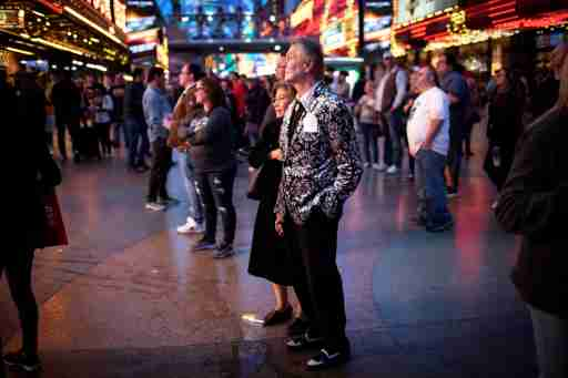 A couple watches street performers in downtown in Las Vegas, Nevada, U.S., February 20, 2020. Picture taken February 20, 2020. REUTERS/Mike Segar