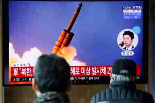 People watch a TV showing a file picture for a news report on North Korea firing two unidentified projectiles, in Seoul, South Korea, March 2, 2020.    REUTERS/Heo Ran
