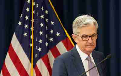FILE PHOTO: U.S. Federal Reserve Chairman Jerome Powell arrives to speak to reporters after the Federal Reserve cut interest rates in an emergency move designed to shield the world's largest economy from the impact of the coronavirus, in Washington, U.S., March 3, 2020. REUTERS/Kevin Lamarque/File Photo