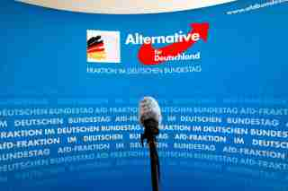A microphone stands in front of an AfD (Alternative fuer Deutschland) logo on the press wall of the German Bundestag in Berlin, March 12, 2020. REUTERS/Michele Tantussi