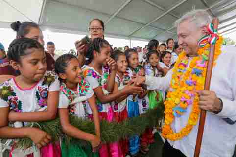 "Mexico's President Andres Manuel Lopez Obrador shakes hands with girlds while visiting towns in the southwestern state of Guerrero, as Mexico's health ministry urged people to mantain a ""healthy distance"" to avoid infection and the spreading of coronavirus (COVID-19), in Ayutla de los LIbres, Mexico March 15, 2020. Mexico's Presidency/Handout via REUTERS ATTENTION EDITORS - THIS IMAGE HAS BEEN SUPPLIED BY A THIRD PARTY. NO RESALES. NO ARCHIVES"