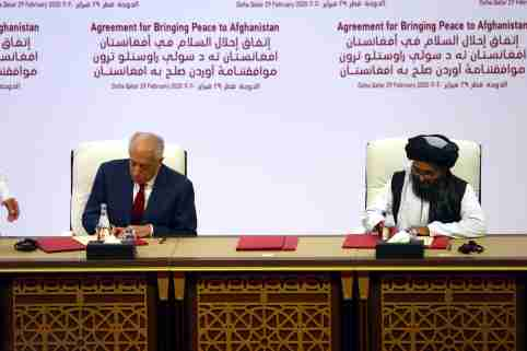 Mullah Abdul Ghani Baradar, the leader of the Taliban delegation, signs an agreement with Zalmay Khalilzad, U.S. envoy for peace in Afghanistan, at a signing agreement ceremony between members of Afghanistan's Taliban and the U.S. in Doha, Qatar February 29, 2020. REUTERS/Ibraheem al Omari