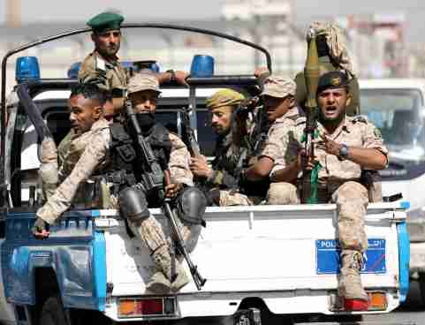 FILE PHOTO: Houthi troops ride on the back of a police patrol truck after participating in a Houthi gathering in Sanaa, Yemen February 19, 2020. REUTERS/Khaled Abdullah/File Photo