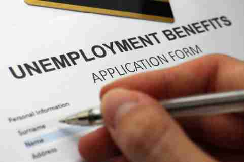 Someone completing an unemployment benefits form.