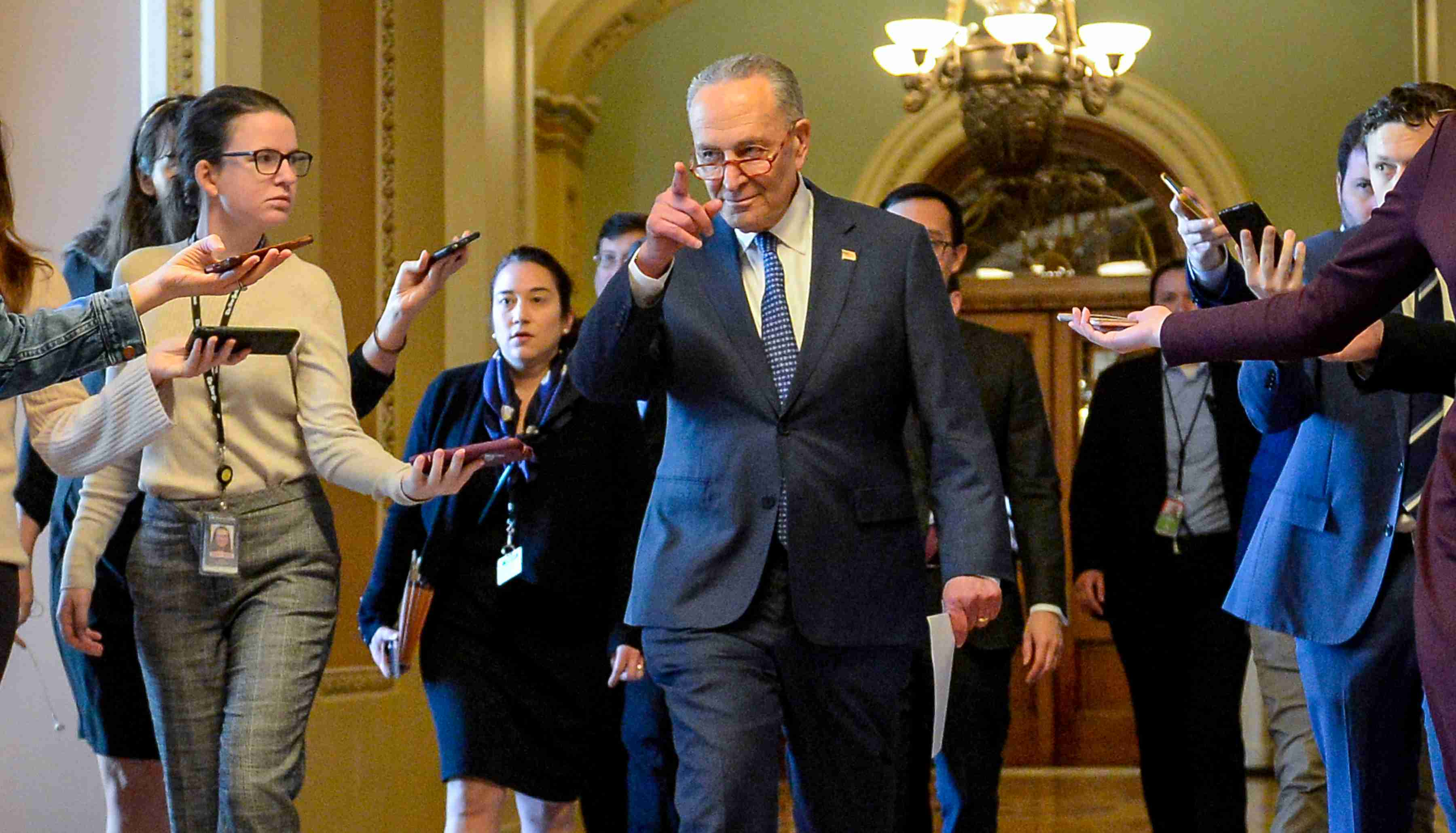 U.S. Senate Minority Leader Chuck Schumer (D-NY)  heads to a meeting in the office of U.S. Senate Majority Leader Mitch McConnell (R-KY) to wrap up work on coronavirus economic aid legislation, during the coronavirus disease (COVID-19) outbreak, in Washington, U.S., March 22, 2020.      REUTERS/Mary F. Calvert