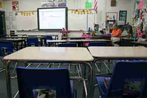 """Petra Burns, a Fairview Middle School 6th grade math teacher, prepares for online instruction from her desk in her empty classroom on """"the second first day of school"""" Monday, March 30, 3030.Second First Day Of School 033020 Ts 051"""