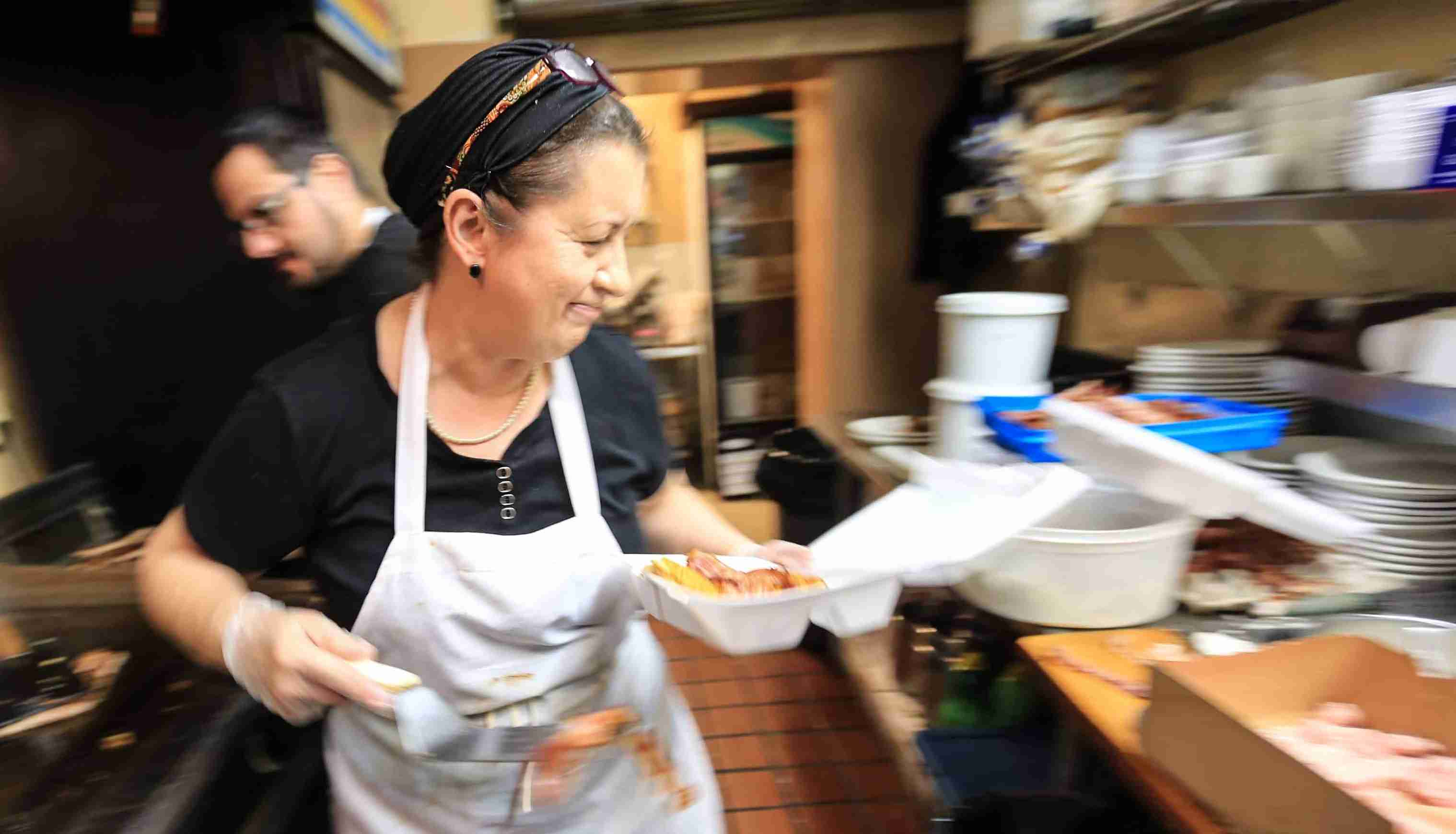 Libby Hantzandreou, owner of Libby's Restaurant on 8th and Tatnall St., cooks up breakfast for her customers in the kitchen.Wil Libby Retires