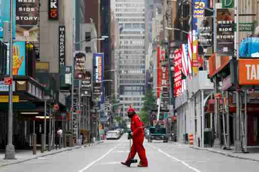 FILE PHOTO: A street cleaner walks through the closed Broadway theatre district near Times Square following the outbreak of the coronavirus disease (COVID-19) in Manhattan, New York City, U.S., May 24, 2020. REUTERS/Andrew Kelly/File Photo