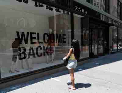 Retail stores start to serve customers indoors as New York City enters phase 2 of reopening in New York on June 22, 2020. A woman doing window shopping at Zara women designer clothing store with huge Welcome Back sign on 1st day of reopening. Governor Andrew Cuomo has announced that New York City is on track for Phase 2 after data shows numbers of new infections and hospitalization is down. (Photo by Lev Radin/Sipa USA)No Use UK. No Use Germany.