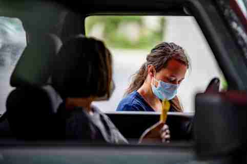 Atealla Betancourt speaks with a doctor before getting tested for the coronavirus disease (COVID-19) during its outbreak, in Austin, Texas, U.S., June 28, 2020. REUTERS/Sergio Flores