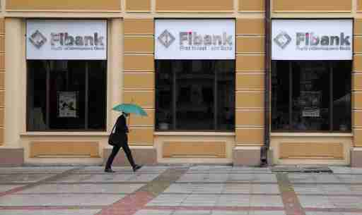A man walks in front of an office of First Investment Bank (Fibank) in Sofia, Bulgaria, June 12, 2020. REUTERS/Stoyan Nenov