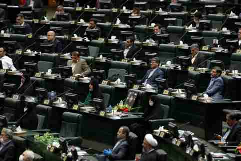 Iranian lawmakers attend the opening ceremony of Iran's 11th parliament, practicing social distancing as the spread of the coronavirus disease (COVID-19) continues, in Tehran, Iran, May 27, 2020. WANA (West Asia News Agency) via REUTERS ATTENTION EDITORS - THIS PICTURE WAS PROVIDED BY A THIRD PARTY