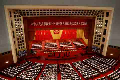 FILE PHOTO: Chinese officials and delegates attend the opening session of the National People's Congress (NPC) at the Great Hall of the People in Beijing, China May 22, 2020. REUTERS/Carlos Garcia Rawlins/File Photo