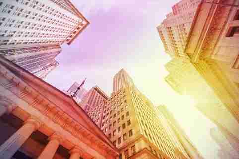 Vintage instagram filtered Wall Street at sunset, Manhattan, New York City, USA.
