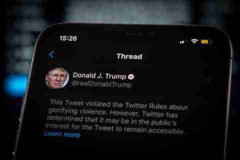 A tweet by US president Donald Trump is seen being flagged as inciting violence by Twitter in this photo illustration on an Apple iPhone in Warsaw, Poland on May 29, 2020. Twitter on May 29 applied a fact-checking label to a vote-in-mail tweet by US President Donald Trump that the company considers misleading. Twitter has recently started labelling tweets with public notification and fact check labels. The labelling of Trump's tweet about the uproar following the death of George Floyd has seen the president signing an executive order targeting the Communications Decency Act. Section 230 which protects social media companies against lawsuits against them for user generated content. (Photo by Jaap Arriens / Sipa USA)No Use UK. No Use Germany.