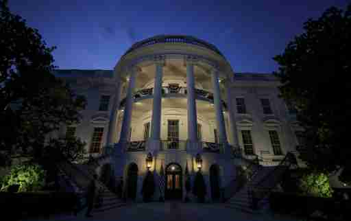 The South Portico and residence of the White House are illuminated before U.S. President Donald Trump and first lady Melania Trump emerged to watch the Washington, D.C. fireworks display from the Truman Balcony while celebrating the U.S. Independence Day holiday at the White House in Washington, U.S., July 4, 2020.   REUTERS/Carlos Barria