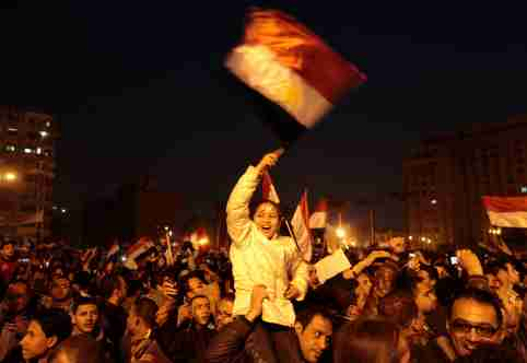 Anti-government protesters celebrate inside Tahrir Square after the announcement of Egyptian President Hosni Mubarak's resignation in Cairo February 11, 2011. Egypt's Vice President Omar Suleiman said on Friday that Mubarak had bowed to pressure from the street and had resigned, handing power to the army, he said in a televised statement. REUTERS/Dylan Martinez   (EGYPT - Tags: POLITICS CIVIL UNREST IMAGES OF THE DAY)
