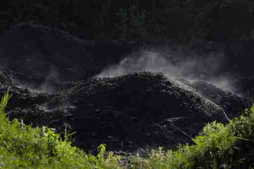 Steam rises from a pile of coal at a mine in Bishop, West Virginia, U.S., May 19, 2018.   REUTERS/Brian Snyder