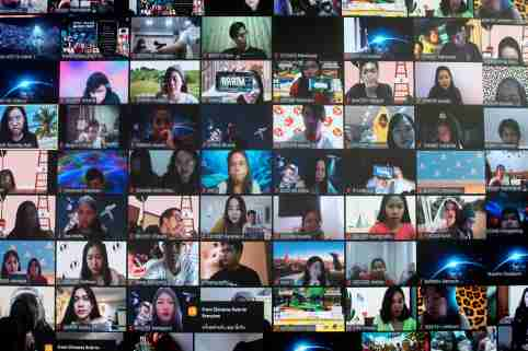 FILE PHOTO: Screens show audience via the Zoom application during the first six-hour online music festival at a studio amid the spread of the coronavirus disease (COVID-19) in Bangkok, Thailand, June 7, 2020. REUTERS/Athit Perawongmetha/File Photo