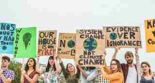 Young people holding signs protesting climate change