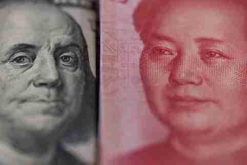 $100 bill and 100 renminbi bills