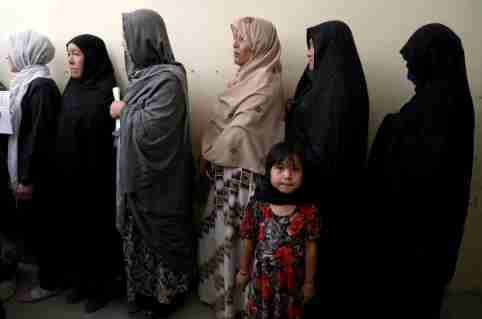 Afghan women line up at a polling station as they wait to cast their votes in Kabul, Afghanistan September 28, 2019.REUTERS/Omar Sobhani