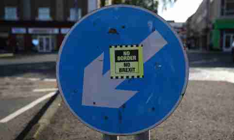 A 'No Border, No Brexit' sticker is seen below a road sign on the Irish side of the border between Ireland and Northern Ireland near Bridgend, Ireland October 16, 2019. Picture taken October 16, 2019. REUTERS/Phil Noble