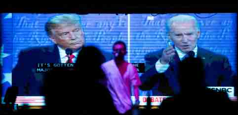People watch the second 2020 presidential campaign debate between Democratic presidential nominee Joe Biden and U.S. President Donald Trump at The Abbey Bar during the outbreak of the coronavirus disease (COVID-19), in West Hollywood, California, U.S., October 22, 2020. REUTERS/Mario Anzuoni