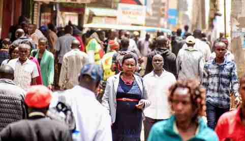 Nairobi, Kenya - April 28 2018: People walking along a busy street in the crowded down town of Nairobi City, Kenya, East Africa