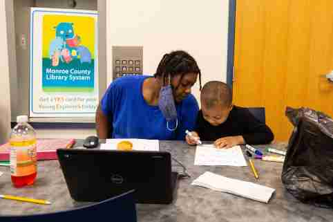 Trachelle Bivins and her 5-year-old son, Ondrae Florence, complete his school work together at the Central Library of Rochester on Tuesday, Sept. 29, 2020. Ondrae would have attended school at School 23, part of the Rochester City School District, if the district had not moved to online learning. Ondrae and his mom have internet at home, but choose to come to the library because it creates a better learning environment for him.urban internet