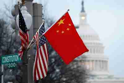 The People's Republic of China flag and the U.S. Stars and Stripes fly on a lamp post along Pennsylvania Avenue near the U.S. Capitol in Washington during Chinese President Hu Jintao's state visit, January 18, 2011. Hu arrived in the United States on Tuesday for a state visit with U.S. President Barack Obama that is aimed at strengthening ties between the world's two biggest economies. REUTERS/Hyungwon Kang (UNITED STATES - Tags: POLITICS CITYSCAPE) - GM1E71J0K0R01