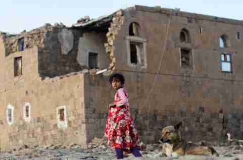 A girl walks near her house destroyed in an air strike carried out by the Saudi-led coalition in Faj Attan village, Sanaa, Yemen December 13, 2018.  REUTERS/Mohamed al-Sayaghi