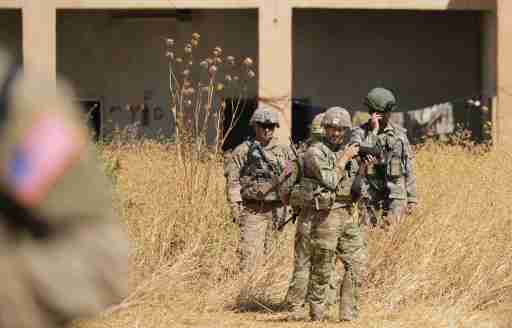 Turkish and American soldiers stand near a former YPG military point during a joint U.S.-Turkey patrol, near Tel Abyad, Syria September 8, 2019. REUTERS/Rodi Said