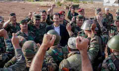 Syrian President Bashar al Assad visits Syrian army troops in war-torn northwestern Idlib province, Syria, in this handout released by SANA on October 22, 2019. SANA/Handout via REUTERS ATTENTION EDITORS - THIS IMAGE WAS PROVIDED BY A THIRD PARTY. REUTERS IS UNABLE TO INDEPENDENTLY VERIFY THIS IMAGE.