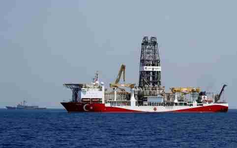 FILE PHOTO: Turkish drilling vessel Yavuz is escorted by Turkish Navy frigate TCG Gemlik (F-492) in the eastern Mediterranean Sea off Cyprus, August 6, 2019. Picture taken August 6, 2019. REUTERS/Murad Sezer/File Photo