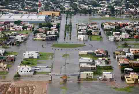 An aerial view of a flooded sector of the border city of Matamoros after being hit by Hurricane Dolly July 24, 2008. U.S. forecasters downgraded Dolly to a tropical depression on Thursday as it dissipated over South Texas. REUTERS/Tomas Bravo (MEXICO)