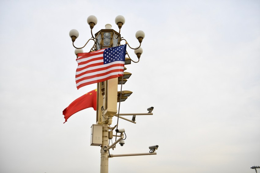 Chinese and American national flags flutter on a lamppost in front of the Tian'anmen Rostrum during the visit of U.S. President Donald Trump in Beijing, China, 8 November 2017.  Chinese President Xi Jinping and his wife Peng Liyuan invited U.S. President Donald Trump and his wife Melania Trump to the Palace Museum, also known as the Forbidden City, after the U.S. president started his state visit to China Wednesday afternoon. Xi and Peng welcomed the guests with afternoon tea at the Hall of Embodied Treasures in the southwestern corner of the Forbidden City.No Use China. No Use France.